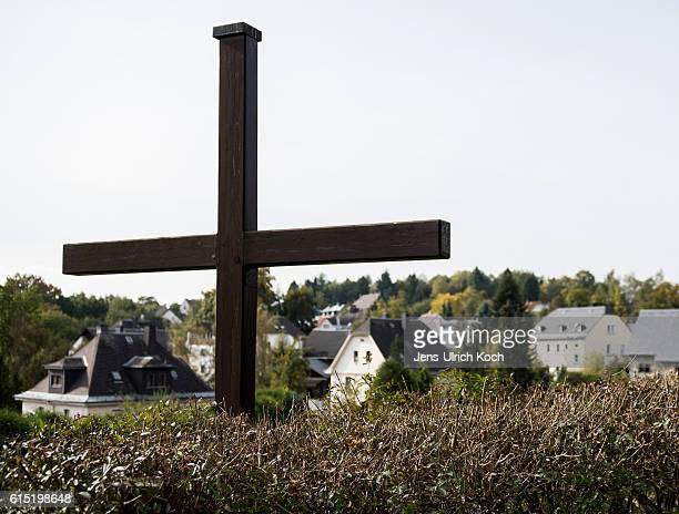 A wooden cross stands at the town edge on October 17 2016 in Lichtenberg Germany Peggy Knobloch a nineyearold disappeared on her way home from school...