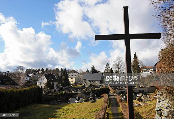 A wooden cross stands on the cemetery of Lichtenberg near Hof southern Germany where a grave was opened on January 8 2014 in connection with the case...