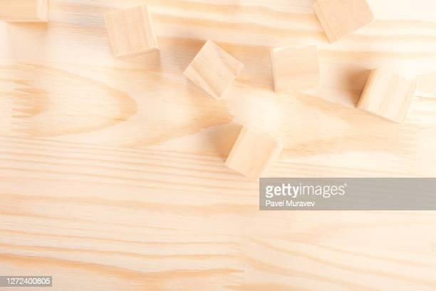 wooden cubes light wooden background warm