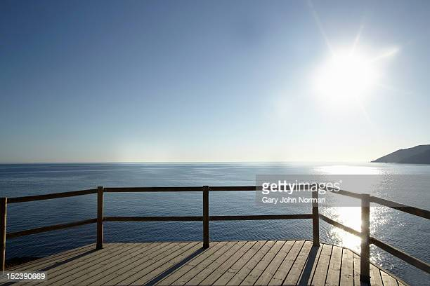 wooden deck and rail facing sea