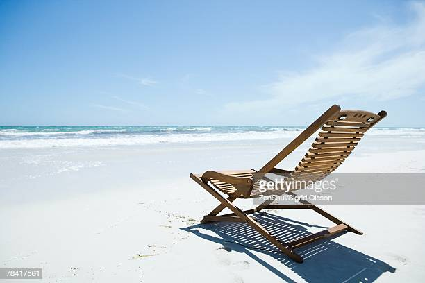 Wooden deckchair on beach