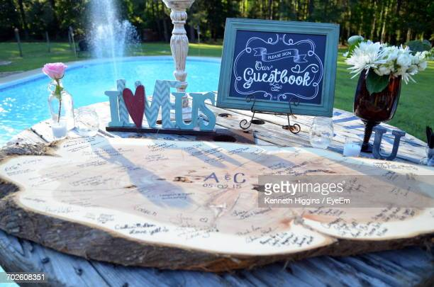 Wooden Decoration On Table At Poolside During Wedding