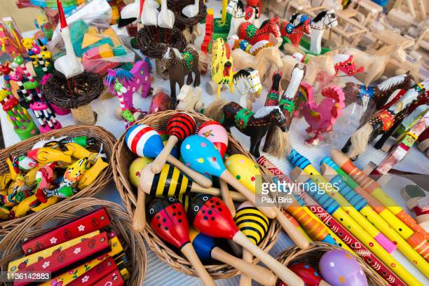 wooden decorations and toys  sold on market in lublin, poland - folk music stock pictures, royalty-free photos & images