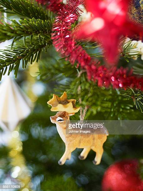Wooden deer decoration on Christmas tree