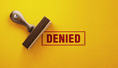 Wooden Denied Stamp On Yellow Background