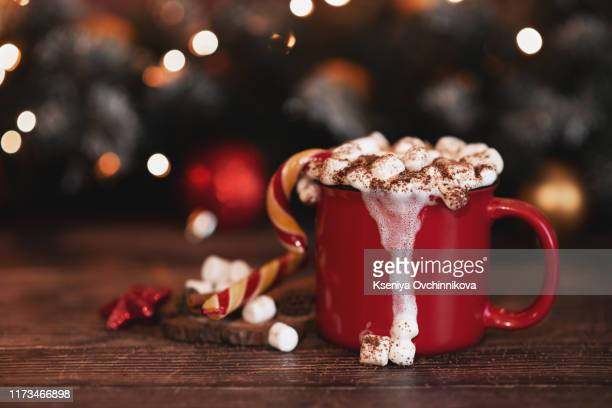 wooden desk space red mug and xmas tree - hot chocolate stock pictures, royalty-free photos & images
