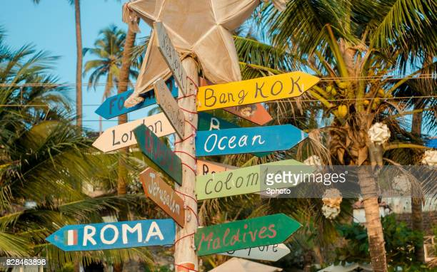 Wooden direction signs at the Cribbean beach