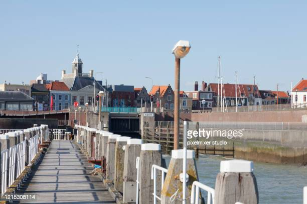 wooden dock in vlissingen - zeeland stock pictures, royalty-free photos & images
