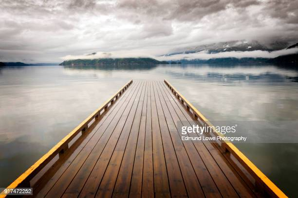 wooden dock on harrison lake, british columbia, canada - jetty stock pictures, royalty-free photos & images
