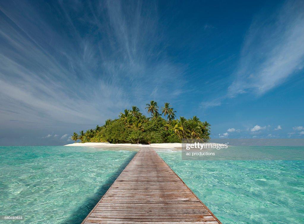 Wooden dock walkway to tropical island : ストックフォト