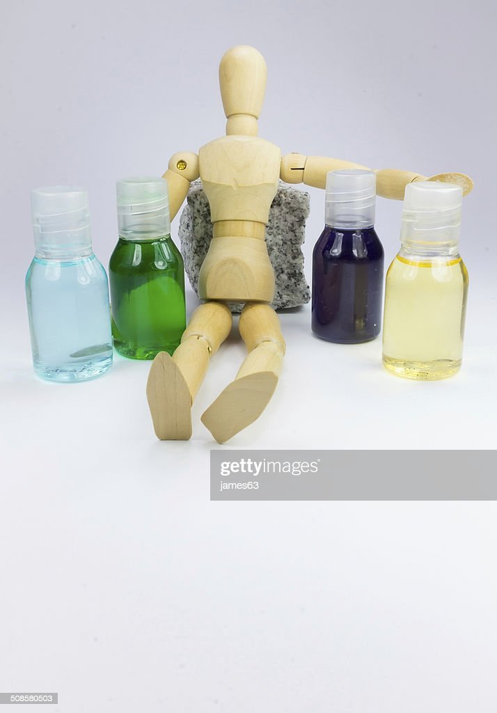wooden doll with colors Blue green purple yellow boats : Stock Photo