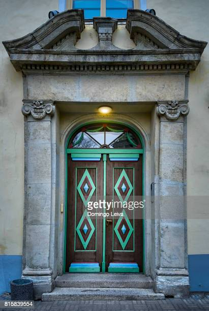 wooden door at facade of riga city council - tallinn stock pictures, royalty-free photos & images