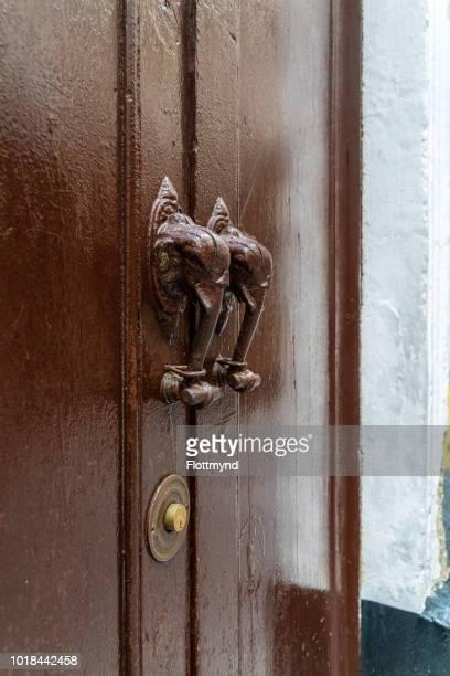 Wooden door  with elephant shaped door knockers, Cadiz, Spain