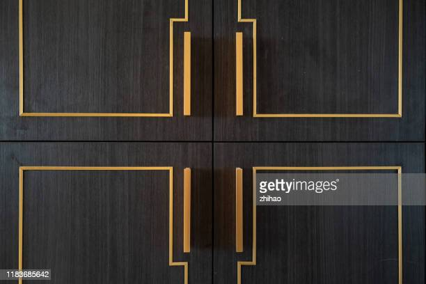 wooden door with metal trim - handle stock pictures, royalty-free photos & images