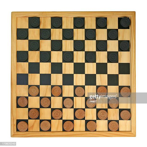 Wooden draught-board with draughts-men, isolated on white