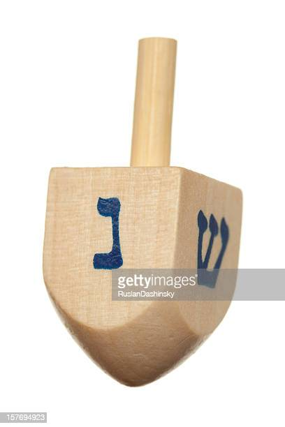 wooden dreidel. - dreidel stock photos and pictures