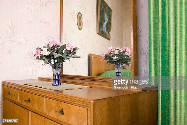A wooden dresser in a bedroom