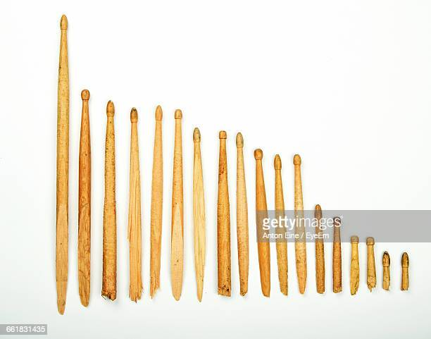 wooden drumsticks arranged against white background - drumstick stock photos and pictures