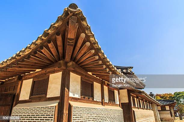 CONTENT] Wooden eaves of annex building at Changdeokgung Palace with blue sky Seoul 2013