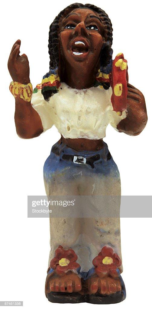 wooden female Rastafarian singing and holding tambourine : Stock Photo