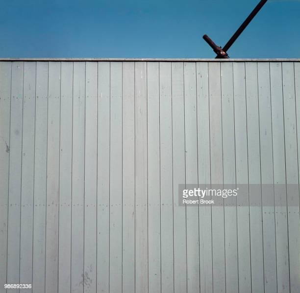 wooden fence around construction site. - english blue film photos stock photos and pictures