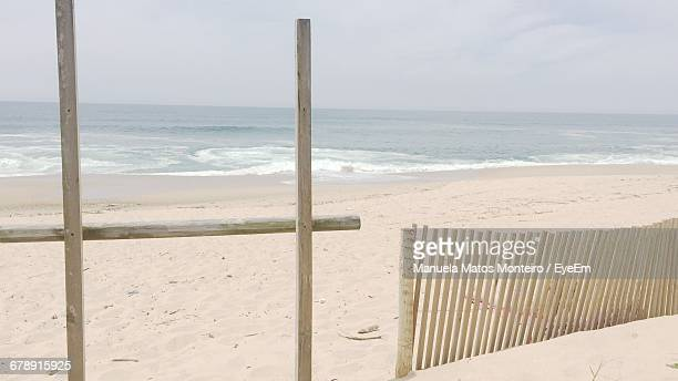 Wooden Fence At Sandy Beach