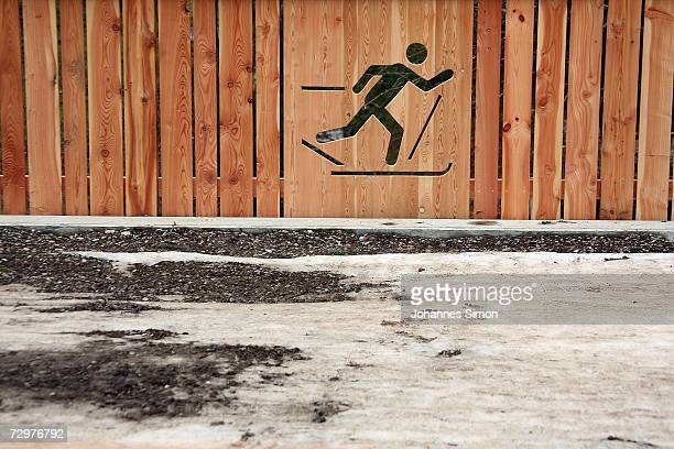 A wooden fence depicts a crosscountry skier next to an abandoned cross country track on January 11 2007 near Fuessen southern Germany The weather...