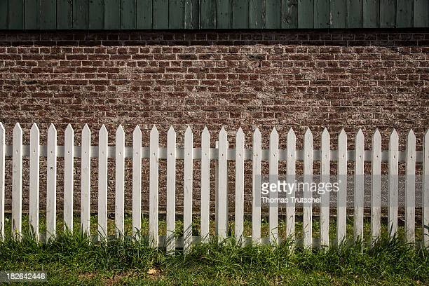 Wooden fence in front of an old house