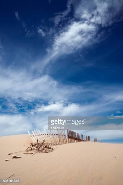 wooden fence in sand dunes, Valdevaqueros beach, tarifa, Cadiz, Andalucia, Spain