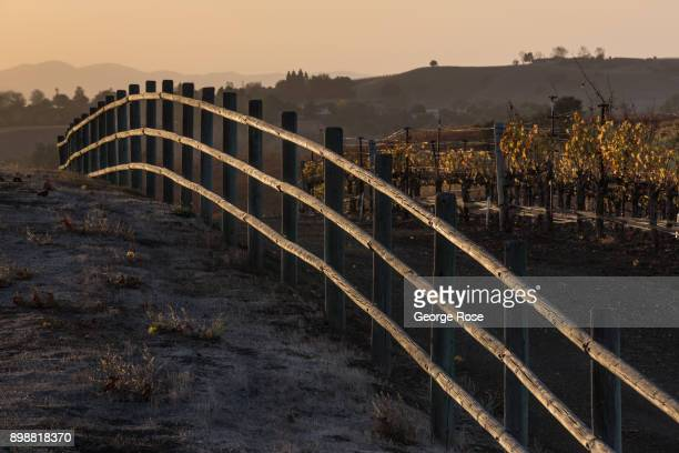 A wooden fence on Happy Canyon Road is lit by a fading sunset on December 17 near Santa Ynez California Because of its close proximity to Southern...