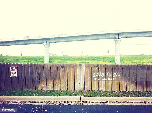 Wooden Fence On Landscape Against Clear Sky