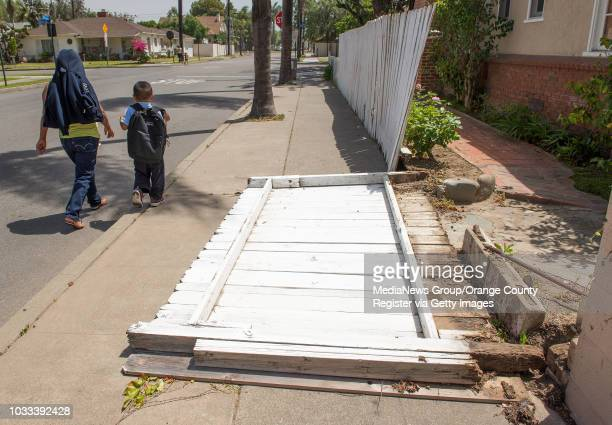 A wooden fence on the 1000block of 15th Street in Santa Ana was blown down in the strong winds Tuesday morning High pressure near the coast and an...