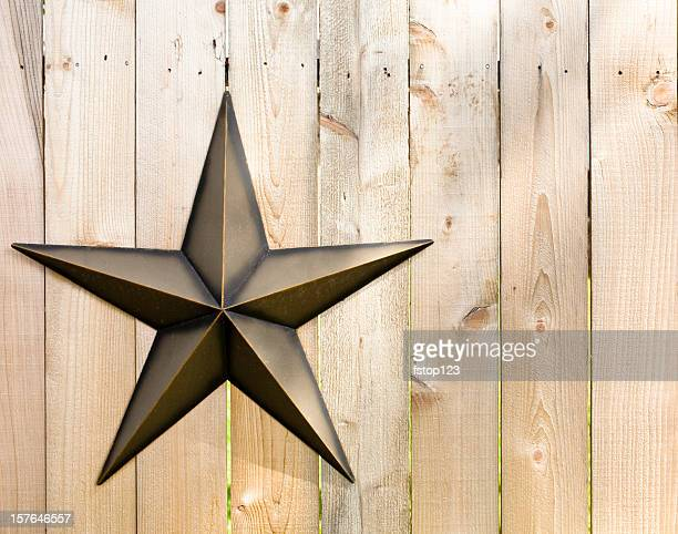 Wooden fence with metal Texas star.