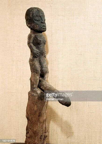 Wooden figure of the Fon vodu Legba with movable penis Legba is a trickster figure who acts as the messenger and linguist of the supreme deity Mawu /...