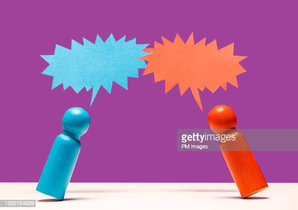 wooden figurines arguing - arguing stock pictures, royalty-free photos & images