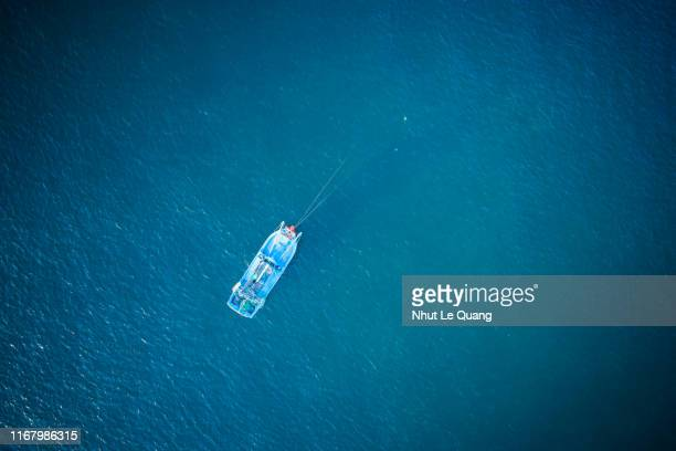wooden fishing boat mooring on the beach - fishing boat stock pictures, royalty-free photos & images