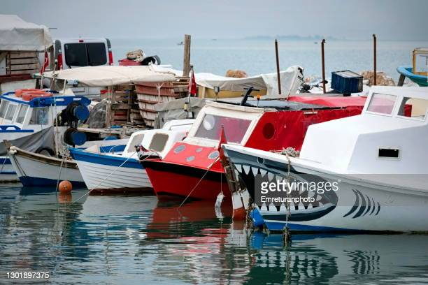 wooden fishing boats anchored in inciralti marina,izmir. - emreturanphoto stock pictures, royalty-free photos & images