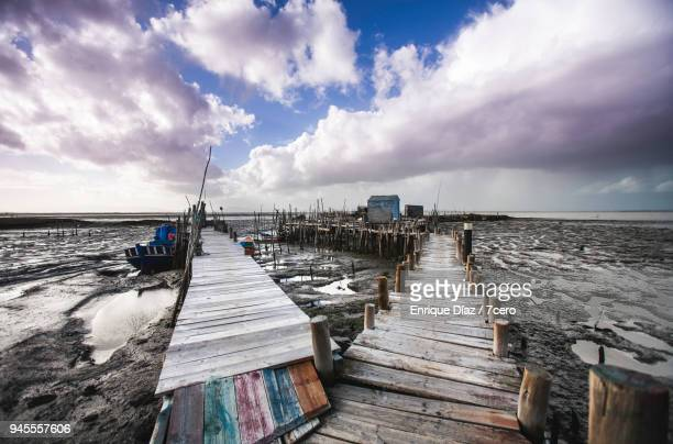 wooden fishing harbour in carrasqueira, portugal - comporta portugal stock photos and pictures