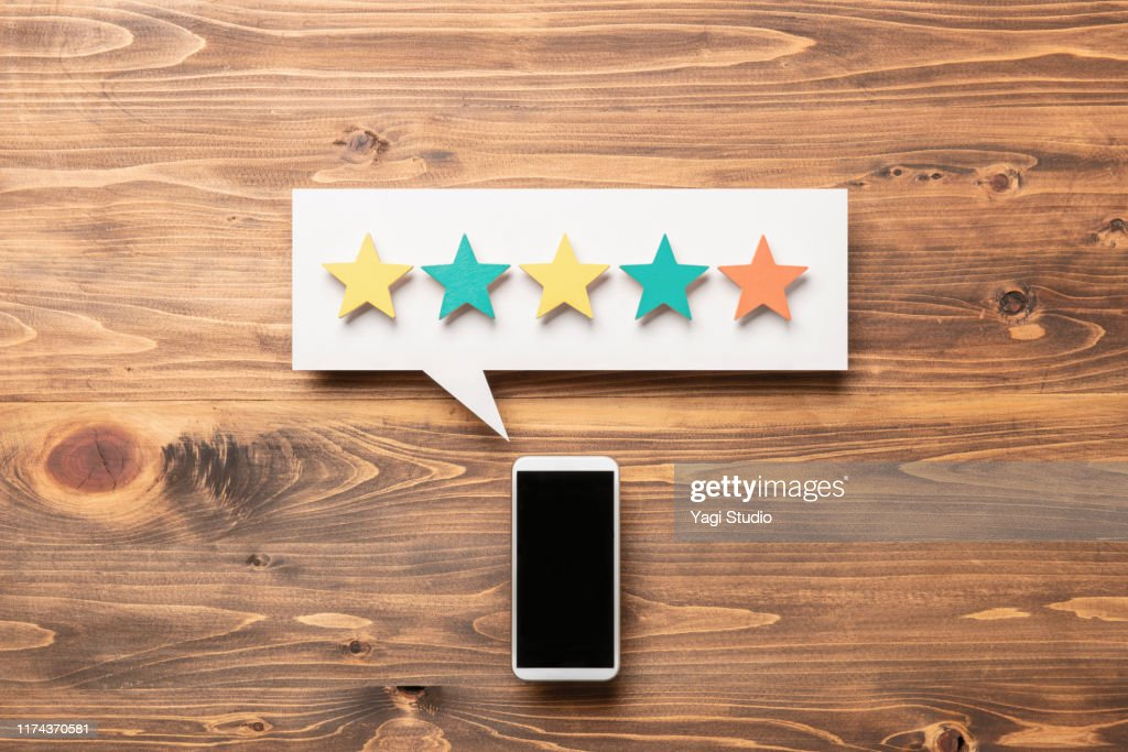Wooden five star shape with Chat Bubble and smart phone. : Stock Photo