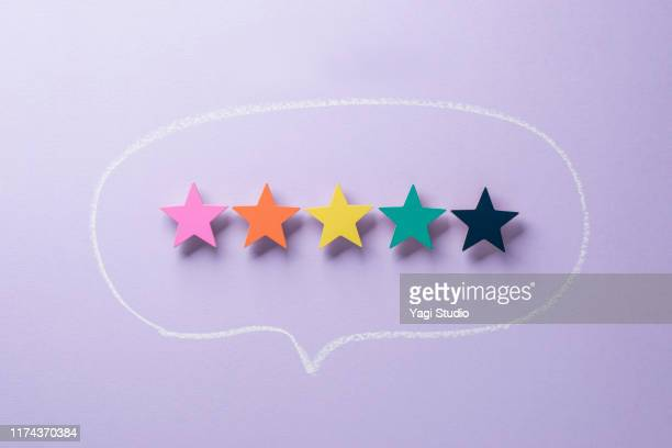 wooden five star shape with chat bubble - customer engagement stock pictures, royalty-free photos & images