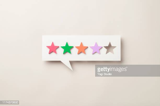 wooden five star shape with chat bubble - scoring stock pictures, royalty-free photos & images