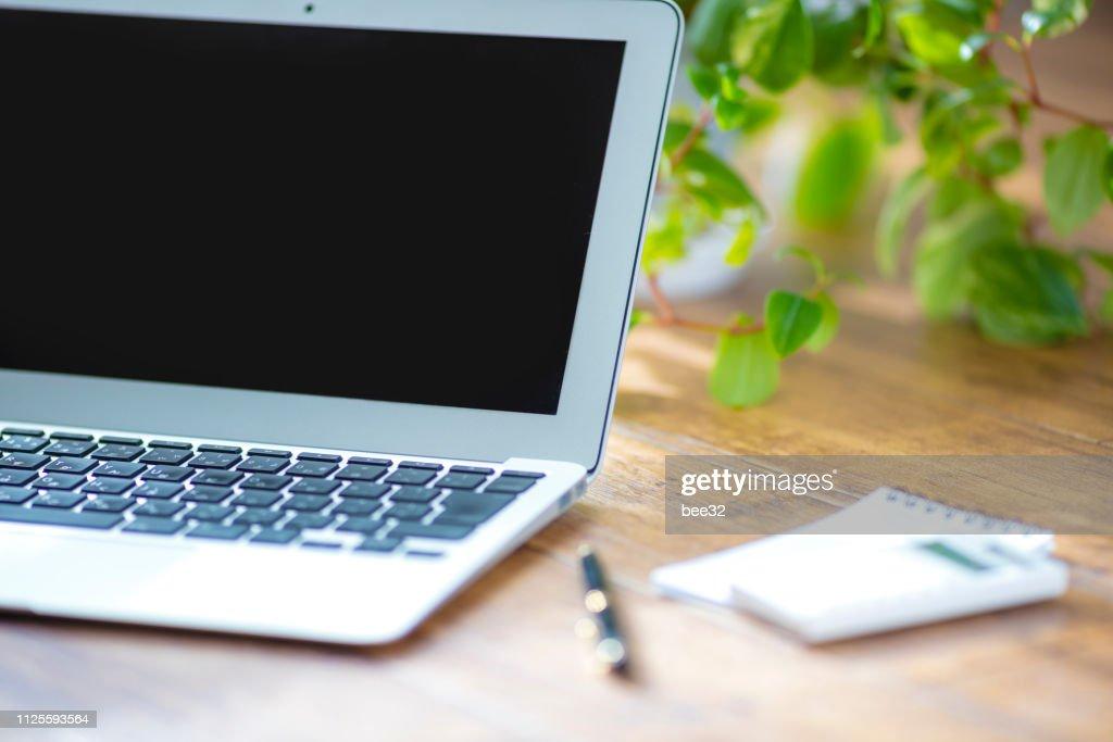 Wooden floor and laptop : Stock Photo