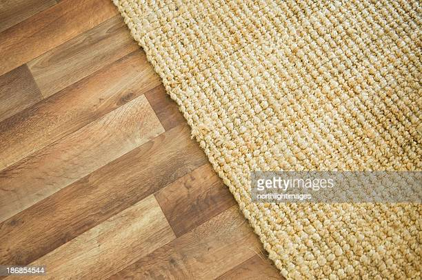wooden floor and rug - tapijt stockfoto's en -beelden