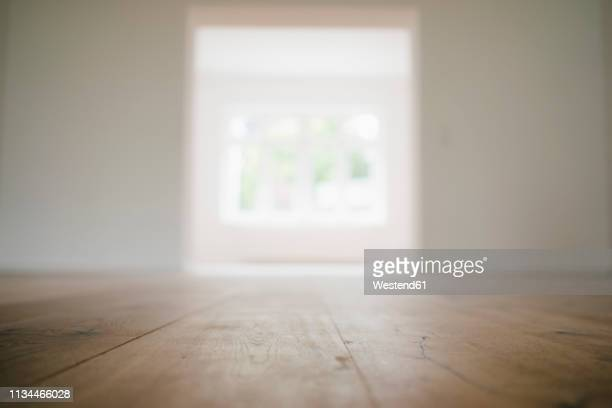 wooden floor in a newly refurbished house - floorboard stock photos and pictures