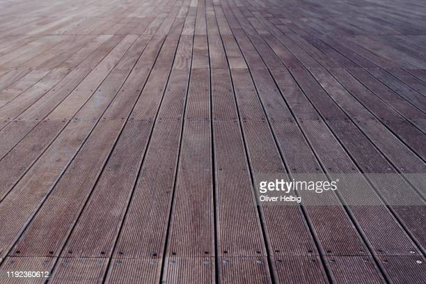 wooden floor in a perspective view - nuts models stock pictures, royalty-free photos & images