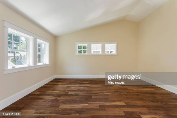wooden floor in empty bedroom - wooden floor stock pictures, royalty-free photos & images