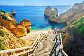 Wooden footbridge to beautiful beach Praia do Camilo near Lagos