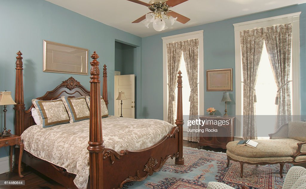 Wooden Four Poster Double Bed In Blue Bedroom