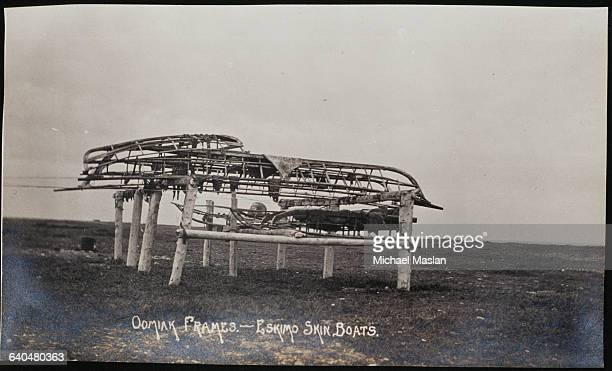 Wooden Frames Of Umiaks Animal Skincovered Boats Made By Inuits Lie Stacked And Ready To Be