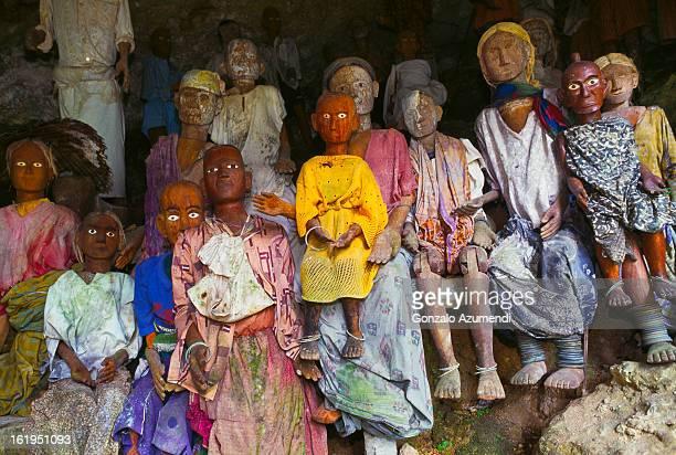 Wooden funeral effgies or tau tau.